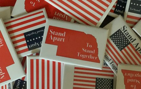 Westside sophomore Luke Steiner recently created  buttons labeled 'Stand Apart to Stand Together' to promote social distancing.