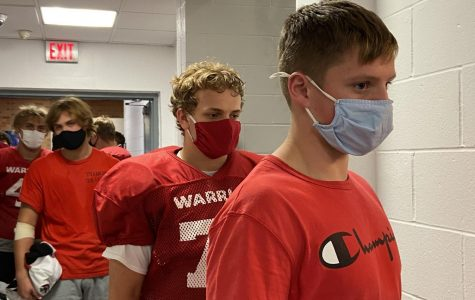 Westside football players wear masks during practices and games to prevent the spread of COVID-19.