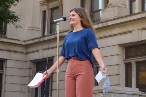 Senior Camille Beaulieu speaks in front of the Douglas County Courthouse during a strike for climate justice on Sept. 25.