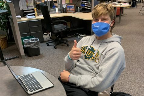 Senior Cole Payton shares his thoughts on if students should stay in school as COVID-19 cases increase.
