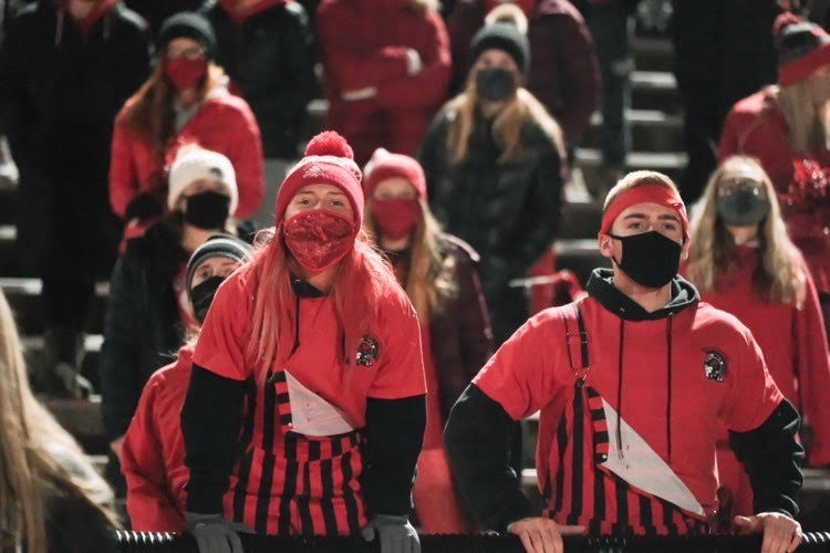 Red Shield leaders Maddy Diprima and Jack Moseman cheer on the Westside football team