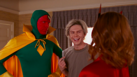 "Wanda (Olsen) and Vision (Bettany) talking with ""Pietro"" (Peters) in their (comics-accurate) Halloween costumes just before trick-or-treating."