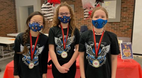 Team members Hattie Cook, Emily Wittrig, and Isabella Higginbotham.