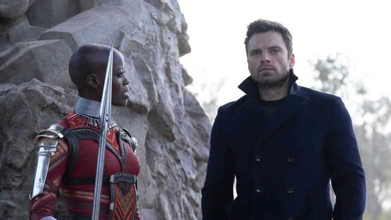 Bucky (Stan) talking to Ayo (Kasumba) after handing over Zemo (Brühl) to the Dora Milaje.