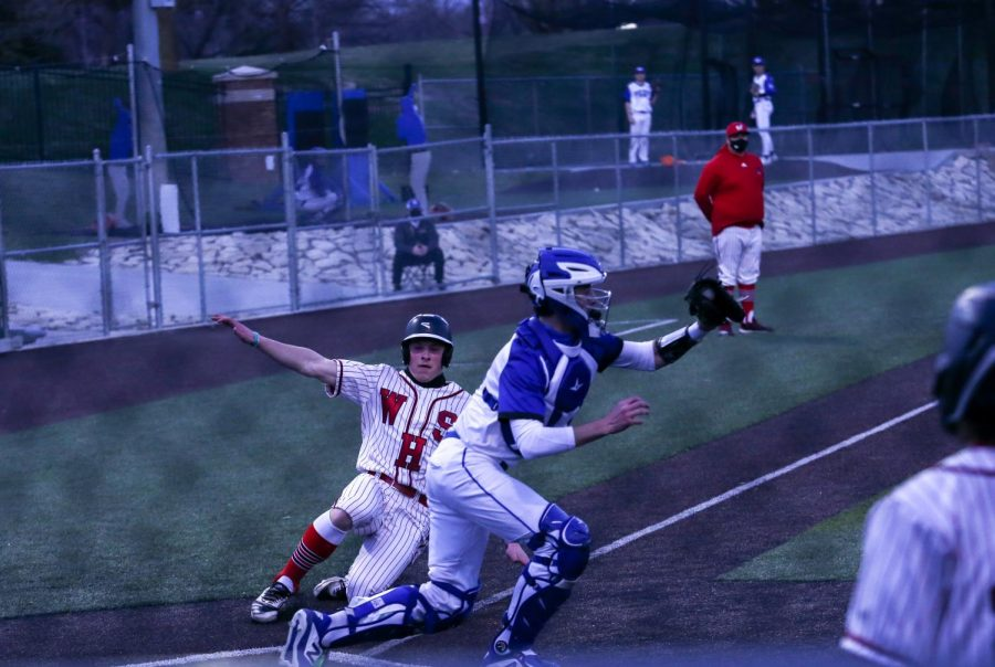 Cole Payton slides late into home plate on Monday's matchup up against the Jr. Jays. - Photo by Zoe Gillespie