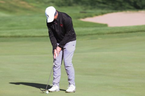 Jacob Hellman looks to putt in at the Lincoln Southwest. Hellman would later win the invite with a 70 and help the team win with a combined 304. Photo by Mary Nilius