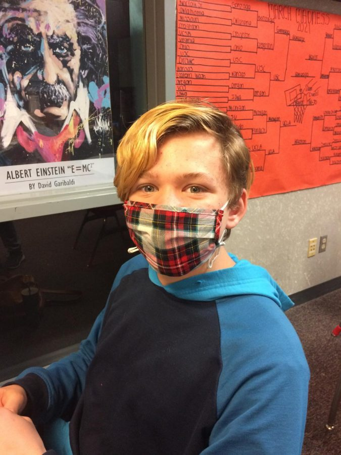 """""""Like, one mask, it could be too loose, but, like, two, it's keeping it closer to your face,"""" freshman Jesse Pitzl"""