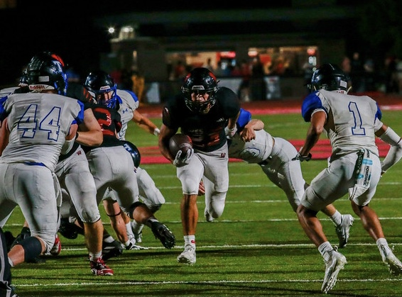 Dominic prepares for two tackle attempts from Papio South defenders. Rezac would break three tackles on this play and run in for his third touchdown on the night in the third quarter. Photo by Zoe Gillespie