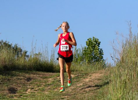 Sophomore Claire White runs in the Class of Metro meet. White placed first among her class. Photo by Eliza Haney