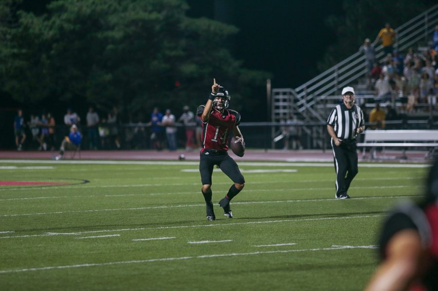 Kolby+Brown+signals+to+Grant+Guyett+for+an+open+touchdown+pass+in+the+end+zone.+-+Photo+by+Zoe+Gillespie