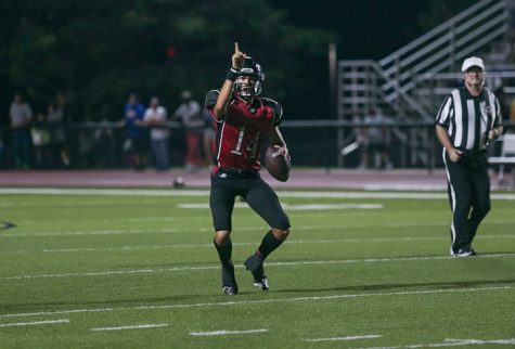 Kolby Brown signals to Grant Guyett for an open touchdown pass in the end zone. - Photo by Zoe Gillespie
