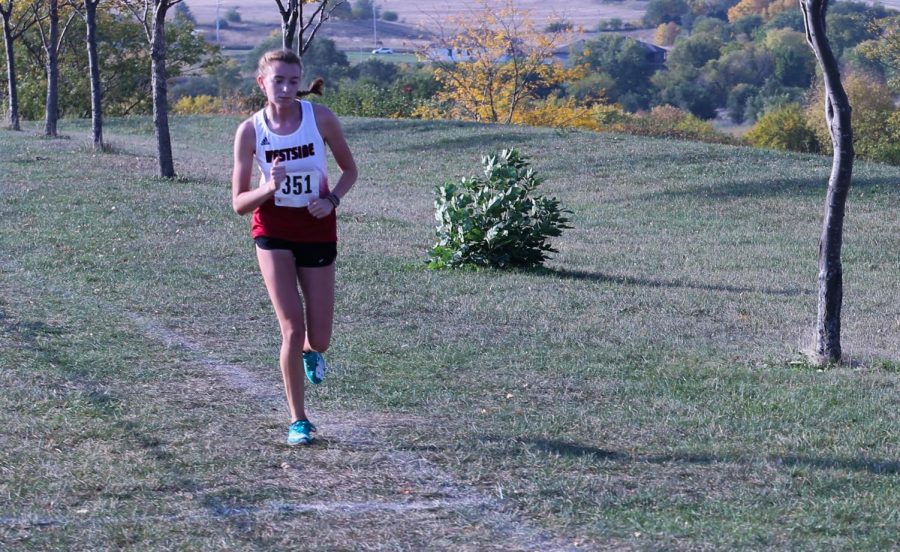 Senior Noelle Abels finished first in the her class at the Class of Metro meet - Photo by Jaden Taylor