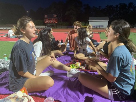 """Seniors chat to pass time during the six hour """"Guard the Field"""" sleepover."""
