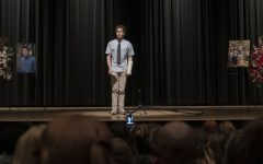Evan Hansen (Platt) attending a remembrance event for Connor Murphy (Ryan).
