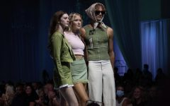 Nelson poses with models all wearing items from her collection För Välden at Omaha Fashion Week.