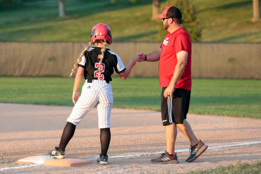 Second Baseman JaLee Conyers stands on first after her first single of the night against Gretna. - Photo by Zoe Gillespie