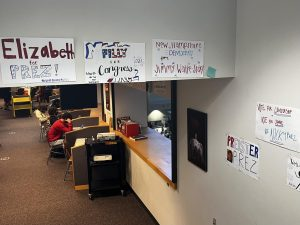 Political candidates display their campaign posters in the Social Studies IMC.