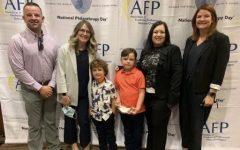 Second grader Ruxin McBride smiles after winning Outstanding Young Philanthropist Award.